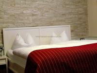 Hotelbau - Hotel Almrausch - Doppelzimmer - Steinwand